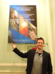 Dan in front of the first annual Ballet Art Exhibition poster at the St Petersburg State Conservatory