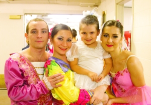 Young dancer with company members in Minneapolis