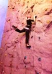 Olga scales the rock climbing wall