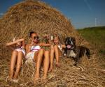 Svetlana and friends play in the hay